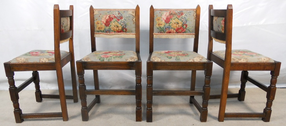 sold set of four oak country look dining chairs with